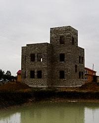 Трехэтажный дом из арболита